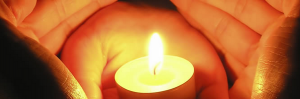 Hands round candle